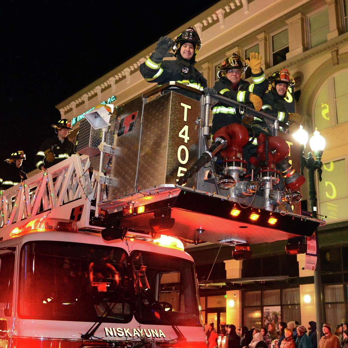 Niskayuna firefighters wave to the crowds during the 46th Annual Gazette Holiday Parade Saturday Nov. 23, 2013, in Schenectady, NY. (John Carl D'Annibale / Times Union)