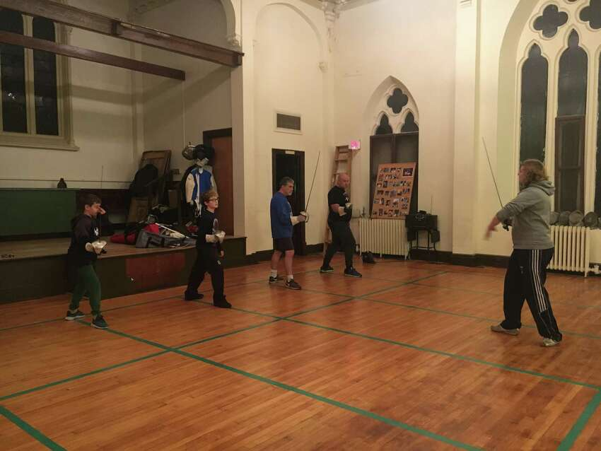 Times Union senior features editor Gary Hahn tried his hand at fencing at the Beaches Sabre Club in Troy, N.Y. (Photo by Tavik Hahn)