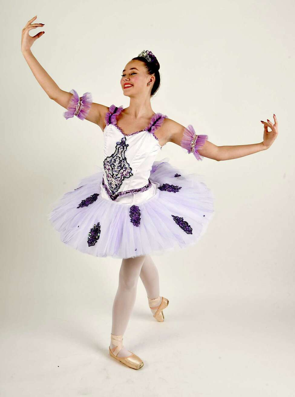 Samantha Percy, who is playing the Sugar Plum Fairy in Northeast Ballet Company's production of the Nutcracker at SPAC, displays her costume with some ballet poses on Tuesday, Oct. 10, 2017 in Colonie, N.Y. (Lori Van Buren / Times Union)