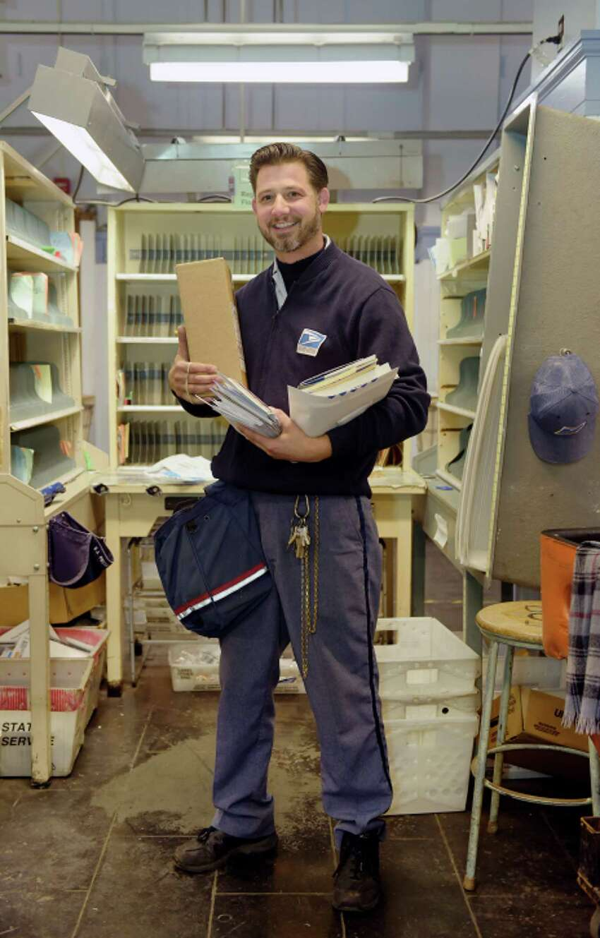 U.S. postal carrier, Andrew Mokey, poses for a photo at the Post Office on Wednesday, Oct. 17, 2018, in Schenectady, N.Y. (Paul Buckowski/Times Union)