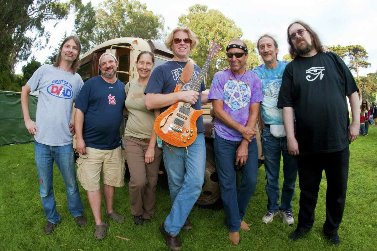 Portrait of Dark Star Orchestra, (L-R) Dino English, Rob Koritz, Lisa Mackey, Rob Eaton, Rob Barraco, Kevin Rosen, Jeff Mattson, backstage at the Hardly Strictly Bluegrass Festival in Golden Gate Park, San Francisco, California, USA on 2nd October 2011. (Photo by Anthony Pidgeon/Redferns)