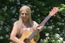 "Guitarist Cheryl Maust recently offered her new album ""Yellow Wings."""