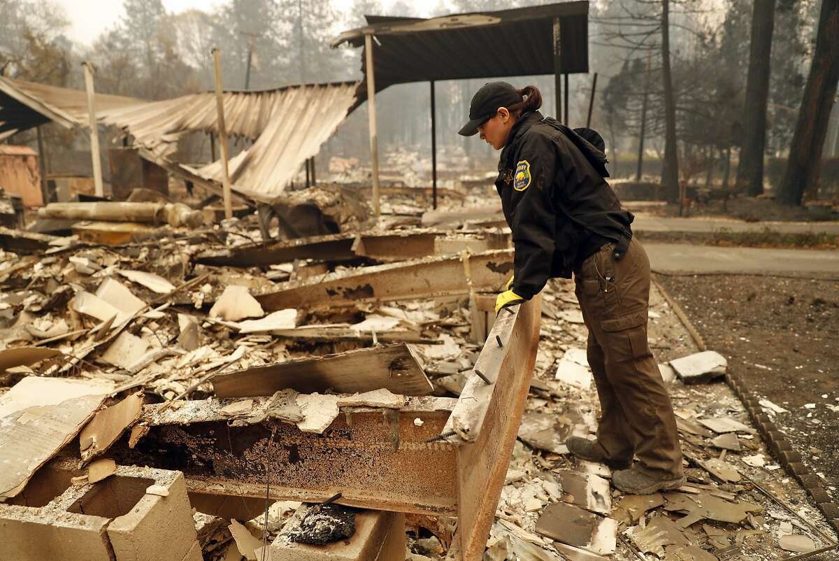 Butte County Investigator Tiffany Larson searches for victims of the Camp Fire in the Pine Springs Mobile Home Park in Paradise, Calif. on Monday, November 12, 2018. Larson lost her home in the wildfire.