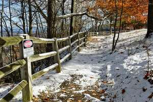 A dusting of snow coats a trail at John Boyd Thacher State Park Wednesday Nov. 14, 2018 in Voorheesville, NY.  (John Carl D'Annibale/Times Union)
