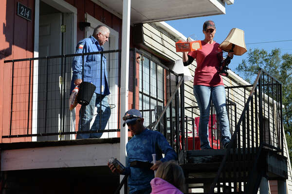 From left, Steve Welch, Mark Welch, Sandy Welch and Becky Welch help Jason Welch, not pictured, move out of his Vidor Apartment Wednesday after a fire caused heavy damage to 16 units at the American Village Apartment complex on Tuesday. Photo taken Wednesday, 11/14/18