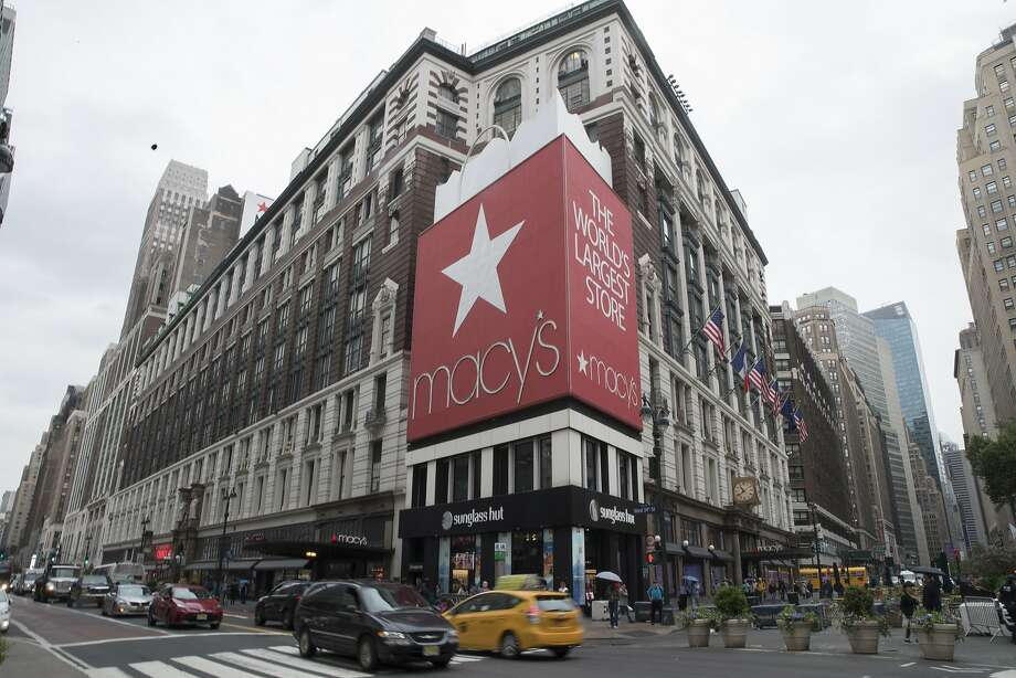 FILE- In this May 16, 2018, file photo, traffic makes it's way past the Macy's flagship store in New York. Macy's Inc. reports earnings Wednesday, Nov. 14. (AP Photo/Mary Altaffer, File) Photo: Mary Altaffer, Associated Press
