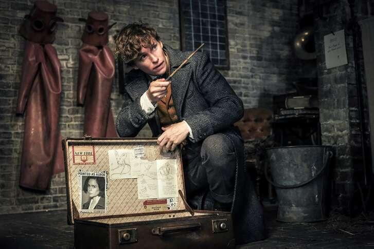 "This image released by Warner Bros. Pictures shows Eddie Redmayne in a scene from ""Fantastic Beasts: The Crimes of Grindelwald."" (Jaap Buitendijk/Warner Bros. Pictures via AP)"