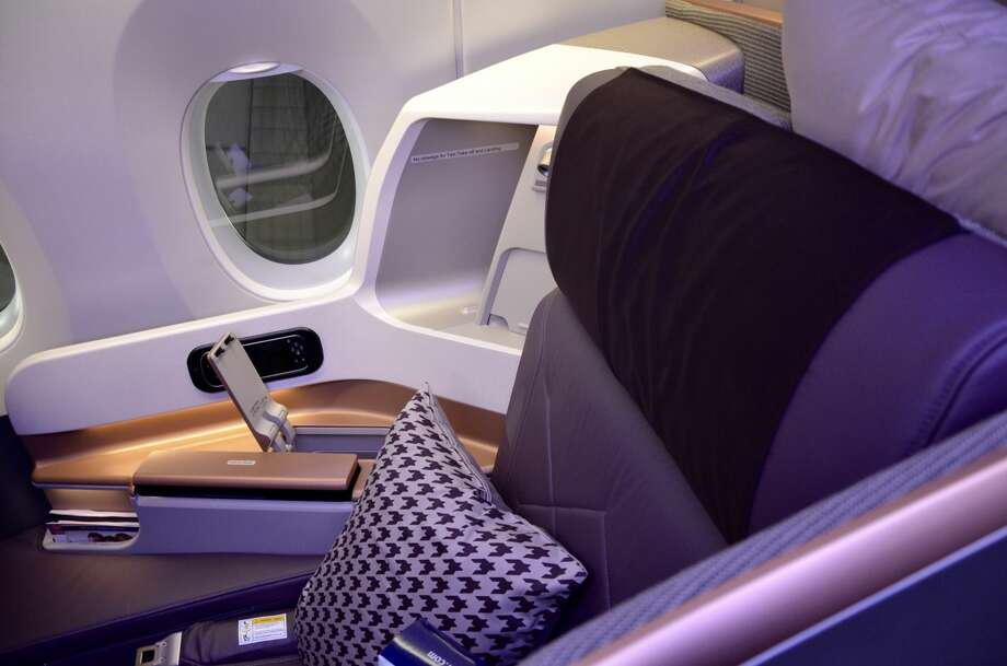Singapore's business class seat provides ample storage space for glasses, wallets, keys and other personal items. Photo: Tim Jue