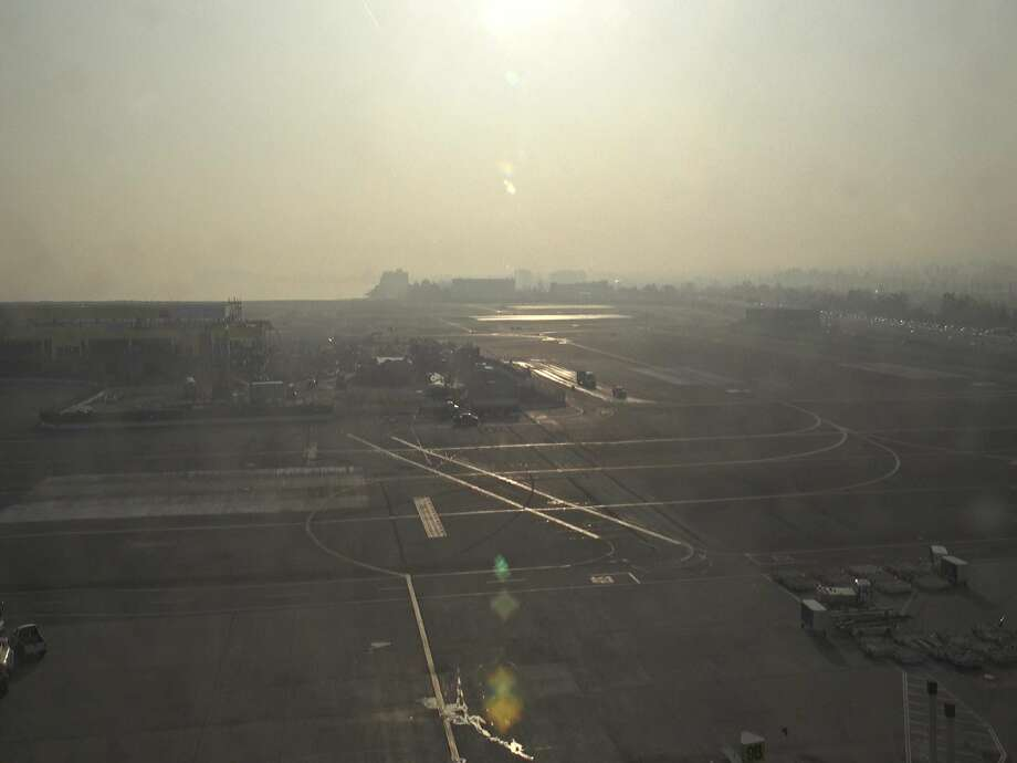 """NWS CWSU Oakland tweeted on Nov. 14, 2018, """"Another day of smoke and haze impacting operations with delays at @flySFO. Little to no improvement of the smoke is anticipated today as low level wind flow is not favorable to push the smoke out of the region. #CampFire #Delays #Smoke."""" Photo: NWS CWSU Oakland / Twitter"""