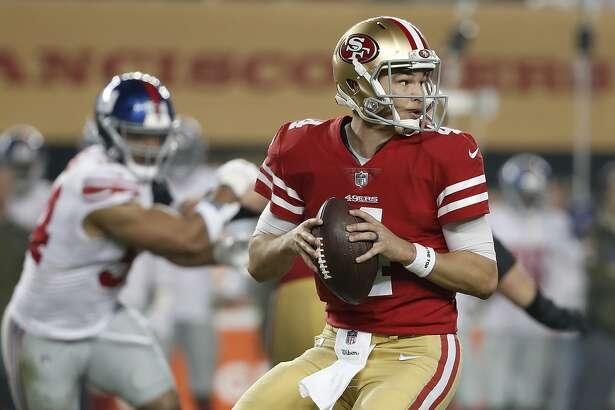 San Francisco 49ers quarterback Nick Mullens (4) passes against the New York Giants during the second half of an NFL football game in Santa Clara, Calif., Monday, Nov. 12, 2018. (AP Photo/Tony Avelar)