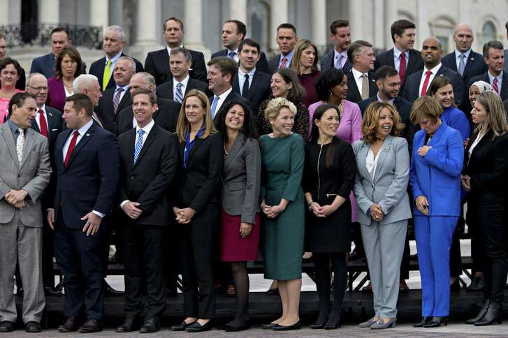 "Member-elects of the 116th Congress wait for a group photo Wednesday outside the U.S Capitol in Washington, D.C. A spokeswoman for the Committee on House Administration says it allows candidates in undecided races, such as Gina Ortiz Jones, fourth from right in bottom row, ""to participate in all of the official programming."""