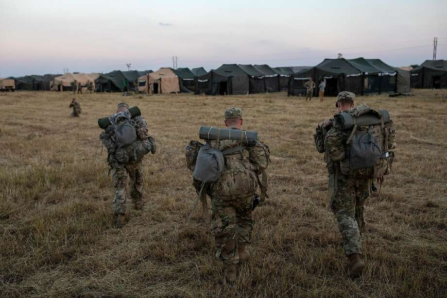 Army soldiers arrive at a base in Donna, Texas, Nov. 8 to help prevent undocumented immigrants from crossing the border. Photo: Tamir Kalifa / New York Times