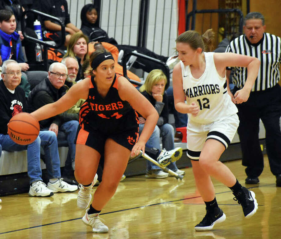 Edwardsville junior Kylie Burg, left, dribbles away from a defender after making a steal in the second quarter on Tuesday in Granite City. Photo: Matt Kamp/Intelligencer