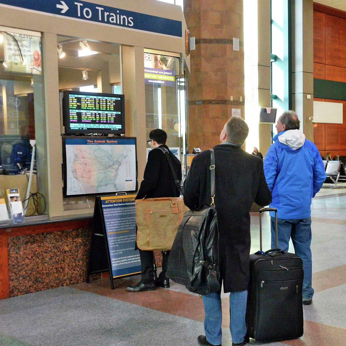 Travelers check a departure/arrival board at the Amtrak station Wednesday Nov. 14, 2018 in Rensselaer, NY. (John Carl D'Annibale/Times Union)