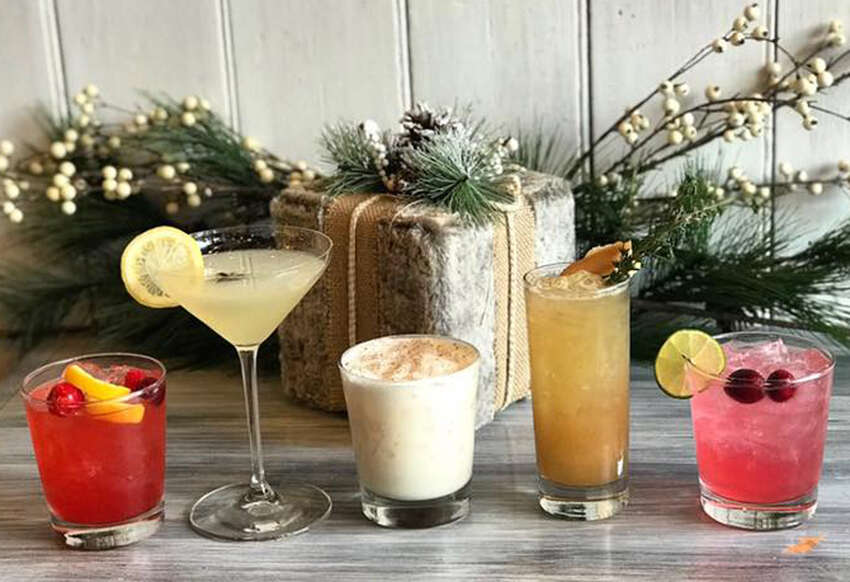 Winter cocktails at The Cuckoo's Nest in Albany include, from left, Fireside Whiskey Sour, Bees Knees, NOLA Milk Punch, Ginger-Pear Bourbon Smash and Yuletide Margarita. (Provided photo.)
