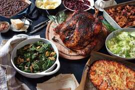 A bountiful Thanksgiving table with, clockwise from top left: apple gingersnap crumble, classic mashed potatoes, red wine cranberry sauce, classic pan gravy, chorizo dressing with leeks, fennel-apple salad with walnuts, roast turkey with orange and sage, and smoky braised kale with tomato, in New York, Oct. 26, 2017. Nine dishes, eight hours, one oven: A blueprint for cooking an entire Thanksgiving meal over the course of one day in an oven and on the four burners above it. (Melina Hammer/The New York Times) ORG XMIT: XNYT99