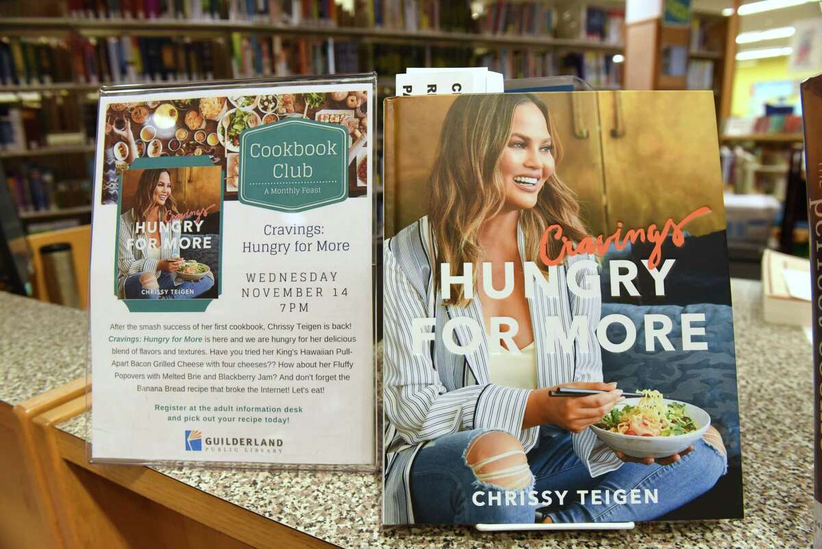 """This month's cooking club book is """"Hungry For More"""" by Chrissy Teigen which is part of the kitchen loan program at Guilderland Public Library on Thursday, Nov. 8, 2018 in Guilderland, N.Y. (Lori Van Buren/Times Union)"""