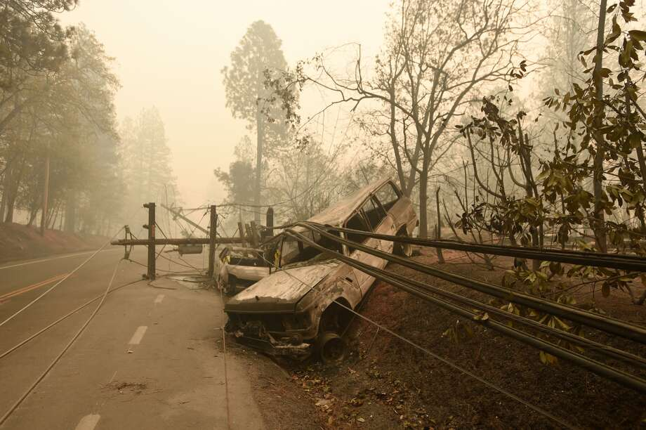 A fallen power line is seen on top of burnt out vehicles on the side of the road in Paradise, California after the Camp fire tore through the area on November 10, 2018. Photo: JOSH EDELSON/AFP/Getty Images