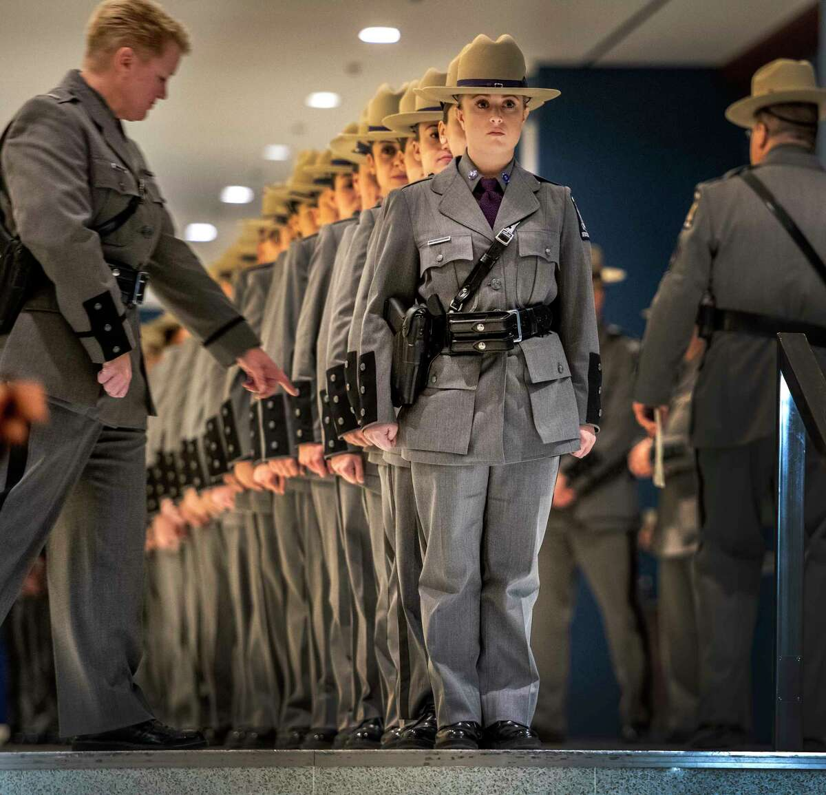 Lt. Christine Baker, left, scrutinizes members of the 207th session of the Basic School at the New York State Police Academy before they march in to the Empire Plaza Convention Center for their graduation ceremony Wednesday Nov. 14, 2018 in Albany, N.Y. (Skip Dickstein/Times Union)