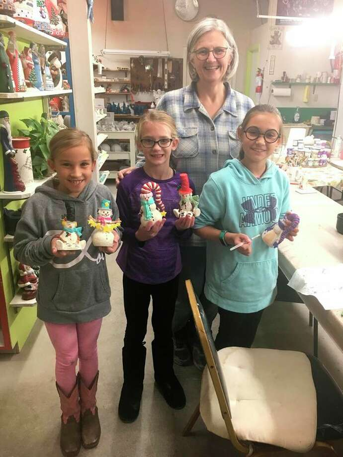 The 4-B's 4-H Club met at Cloud of Dust Ceramics in Pigeon. Pictured are Hailey McCrea, Khloe Krohn and Zoey McCrea with Laurie Cook of Cloud of Dust Ceramics and their projects. (Submitted Photo)