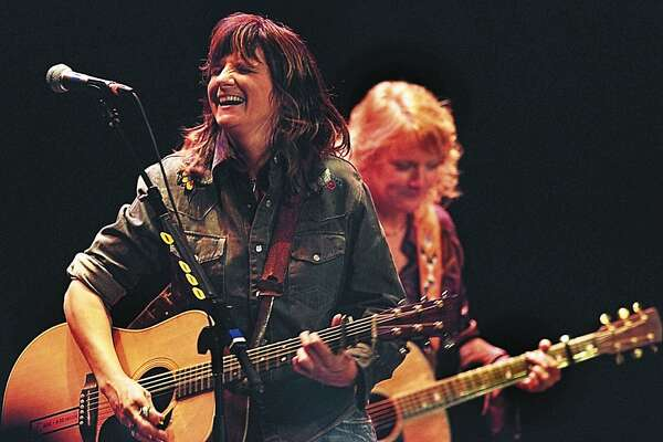 "The Indigo Girls, Amy Ray, left, and Emily Saliers, perform for a sell-out crowd at the Colonial Theater in Keene, N.H., on Tuesday Nov. 9, 2004. The duo have performed together for 20 years and are known for their first-rate harmonies and memorable lyrics. Keene was the next-to-the-last stop on their tour promoting a new CD, ""All That We Let In."" (AP Photo/The Keene Sentinel, Michael Moore)"