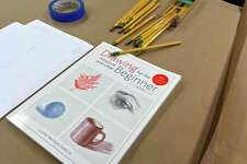 """Some of the basics for Claire Watson Garcia's first class of """"Drawing for the Absolute and Utter Beginner,"""" lay on a table Oct. 2, 2018, in a classroom at Silvermine Arts Center in New Canaan, Connecticut. The course runs through Dec. 11, 2018. Watson Garcia has taught this popular course for many years. The principles and exercises she employs in the class are shared in her book, """"Drawing for the Absolute and Utter Beginner,"""" which just celebrated its 15th anniversary edition."""