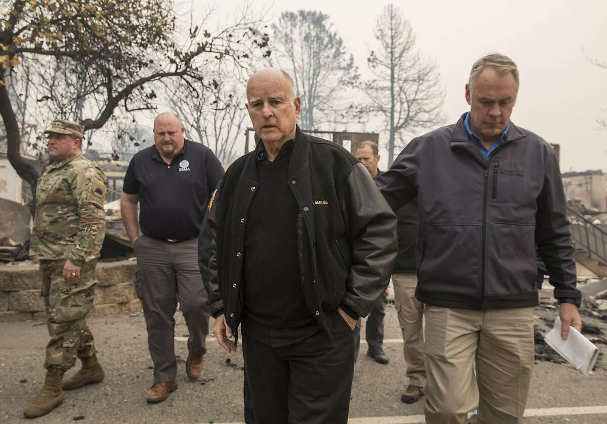 California Governor Jerry Brown and U.S. Secretary of the Interior Ryan Zinke tour the rubble of Paradise Elementary School in Paradise, Calif. Wednesday, Nov. 14, 2018 after the Camp Fire destroyed the school and most of the town.