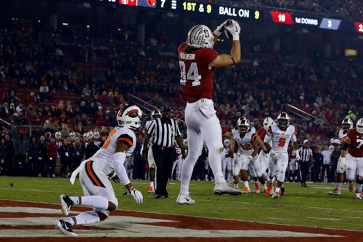 PALO ALTO, CA - NOVEMBER 10: Tight end Colby Parkinson #84 of the Stanford Cardinal catches a pass for a touchdown in front of safety Jeffrey Manning Jr. #15 of the Oregon State Beavers during the second quarter at Stanford Stadium on November 10, 2018 in Palo Alto, California. (Photo by Jason O. Watson/Getty Images)