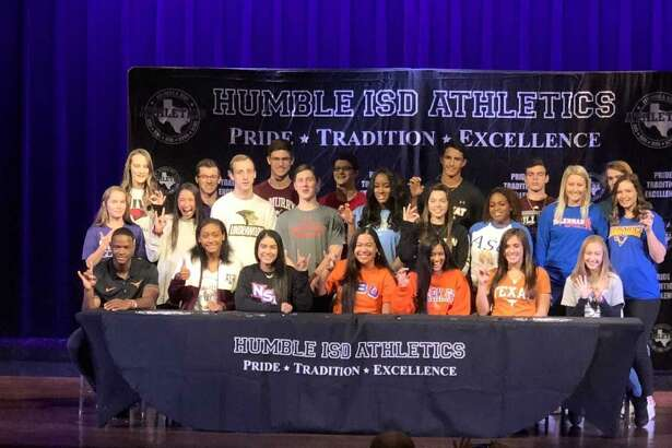 Humble ISD had 24 student athletes make their commitments official on National Signing Day on Thursday at Charles Bender Performing Arts Center.