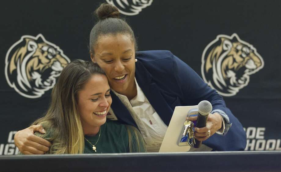 Augustina Demagistris gets a hug from Conroe girls soccer coach Cauley Kesha after signing with Missouri University of Science & Technology during a national signing day ceremony at Conroe High School, Wednesday, Nov. 14, 2018, in Conroe. Photo: Jason Fochtman/Staff Photographer
