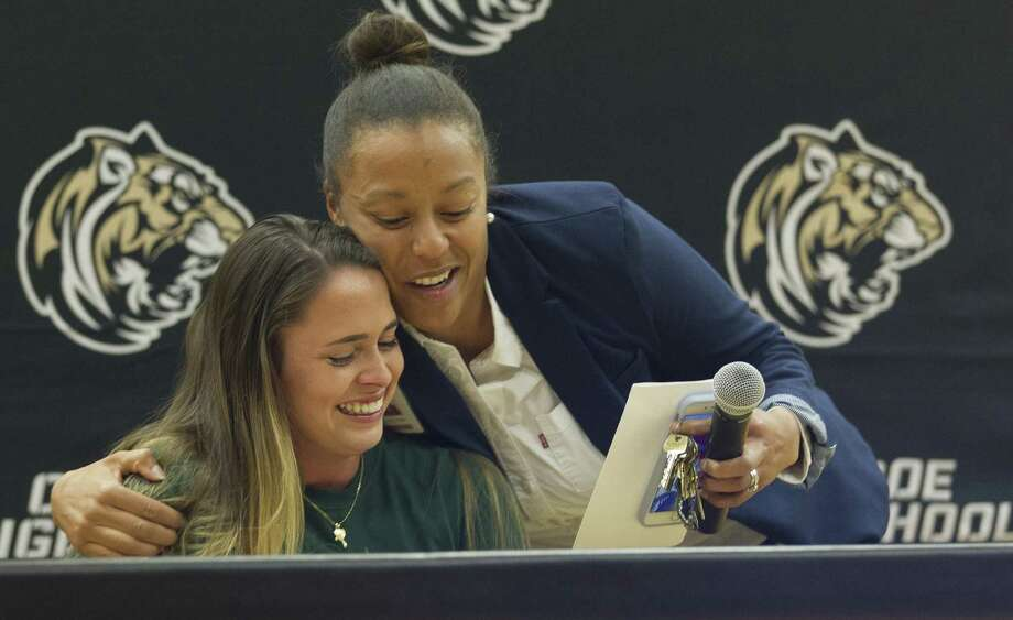 Augustina Demagistris gets a hug from Conroe girls soccer coach Cauley Kesha after signing with Missouri University of Science & Technology during a national signing day ceremony at Conroe High School, Wednesday, Nov. 14, 2018, in Conroe. Photo: Jason Fochtman, Houston Chronicle / Staff Photographer / © 2018 Houston Chronicle