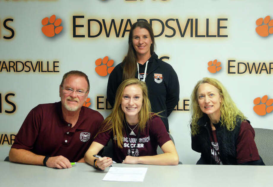 Edwardsville senior Emma Hensley signed to play soccer at Missouri State University. In the front row, from left to right, are father Roger Hensley, Emma Hensley and mother Cathy Hensley. EHS coach Abby Federmann is standing. Photo: Scott Marion/Intelligencer