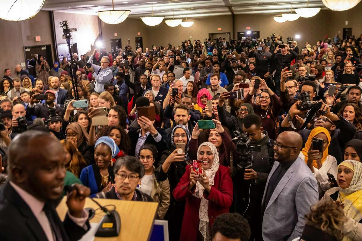 Supporters wait eagerly for the arrival of Ilhan Omar, newly elected to the U.S. House of Representatives on the Democratic ticket, during her victory party on election night in Minneapolis, Minnesota on November 6, 2018. - US voters elected two Muslim women, both Democrats, to Congress on November 6, 2018, marking a historic first in a country where anti-Muslim rhetoric has been on the rise, American networks reported. Ilhan Omar, a Somali refugee, won a House seat in a heavily-Democratic district in the Midwestern state of Minnesota, where she will succeed Keith Ellison, himself the first Muslim elected to Congress. (Photo by Kerem Yucel / AFP)KEREM YUCEL/AFP/Getty Images