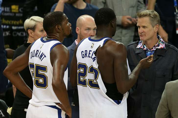 OAKLAND, CA - OCTOBER 27: Golden State Warriors coach Steve Kerr talks with Draymond Green (23) following his ejection for a scuffle as Kevin Durant (35) looks on during the Golden State Warriors game versus the Washington Wizards on October 27, 2017 at Oracle Arena in Oakland, CA. (Photo by Daniel Gluskoter/Icon Sportswire via Getty Images)
