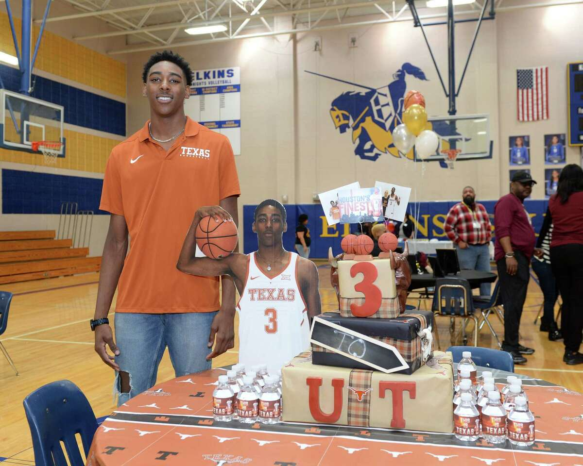 Donovan Williams prepares to sign a commitment to play basketball for the University of Texas during a ceremony at Elkins High School in Missouri City, TX on November 14, 2018.