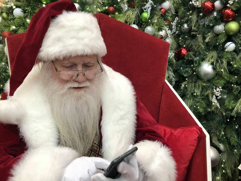 PHOTOS: Houston's best holiday traditions Santa Claus at The Galleria checks to see if his reindeer have texted him back yet. >>>Learn about some of Houston's favorite holiday traditions... Photo: Craig Hlavaty
