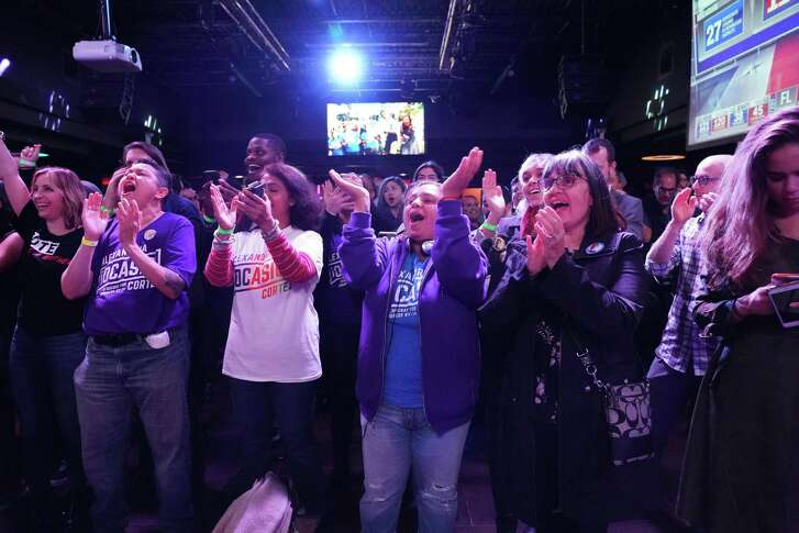 Supporters of Alexandria Ocasio-Cortez cheer during her election night party in the Queens Borough of New York on November 6, 2018.
