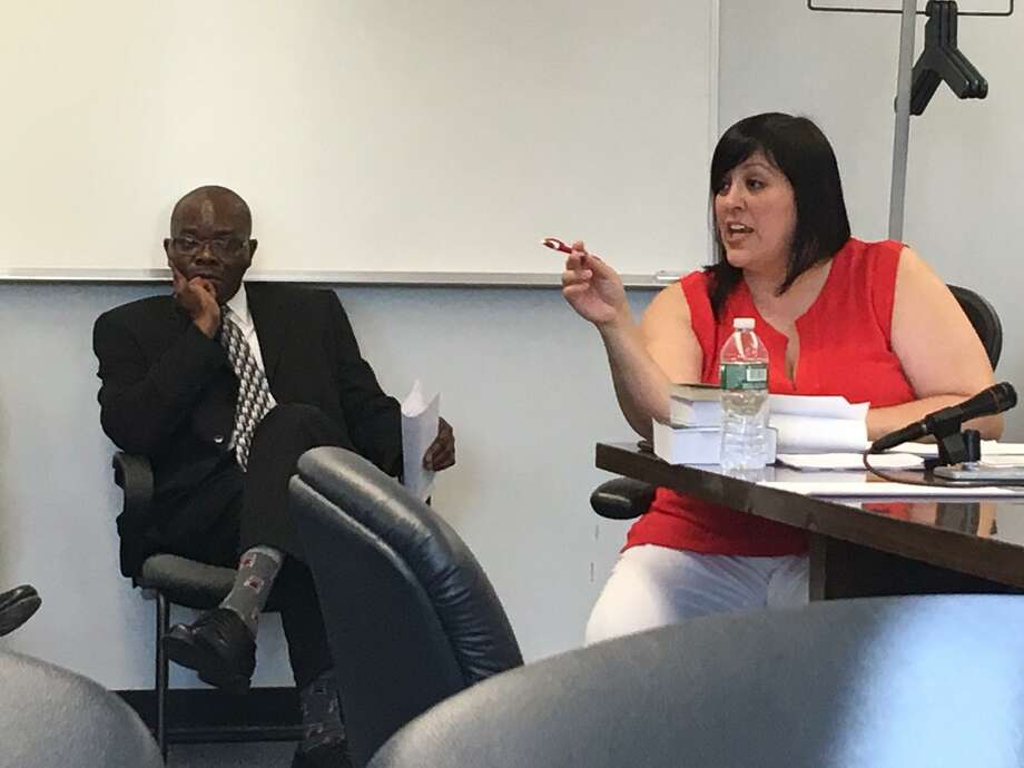 City Budget Director Nestor Nkwo and school board member Maria Pereira at a special meeting of the school board on Wednesday, June 28, 2017. Photo: Linda Conner Lambeck / Linda Conner Lambeck