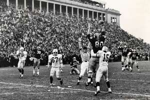 Harvard's Pete Varney (80) catches Frank Champis' two-point conversion pass in front of Yale's Ed Franklin (15) to tie the rivalry game 29-29 on Nov. 23, 1968.