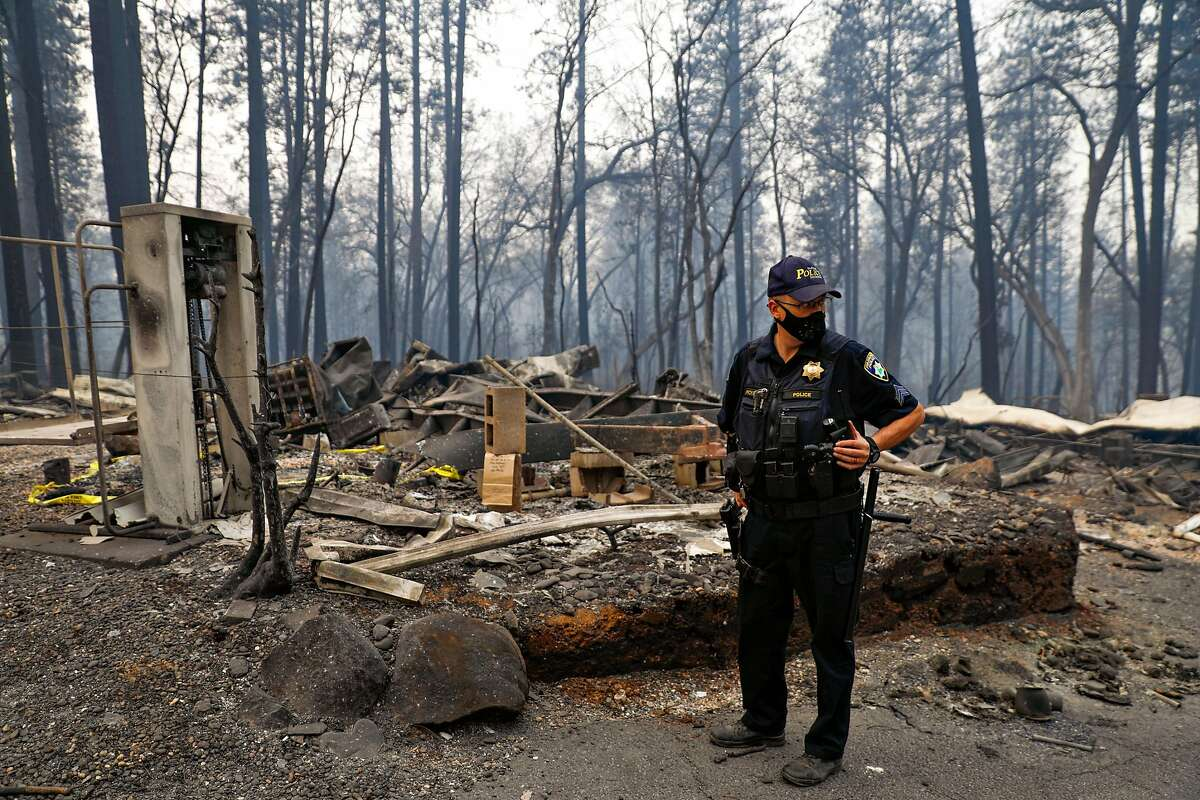 Sgt. Robert Pickering patrols the area following the Camp Fire in Paradise, California, on Wednesday, Nov. 14, 2018.