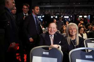 Casino magnate Sheldon Adelson, and wife Miriam attend the first debate between Hillary Clinton and Donald Trump in 2016. Trump will bestow the the nation's highest civilian award on Miriam Adelson.