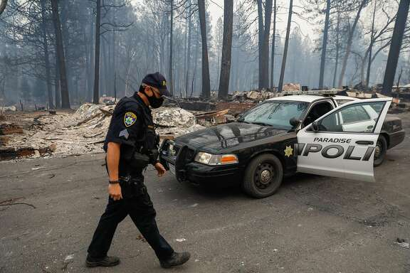 Sgt. Robert Pickering goes back to his cop car while patrolling on Libby Road following the Camp Fire in Paradise, California, on Wednesday, Nov. 14, 2018.