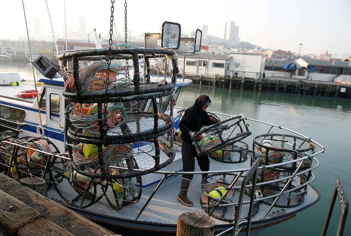 Matt Zidek stacks crab pots on the deck of the New Rayann fishing boat at Pier 45 for the opening of the commercial crab season in San Francisco, Calif. on Wednesday, Nov. 14, 2018.