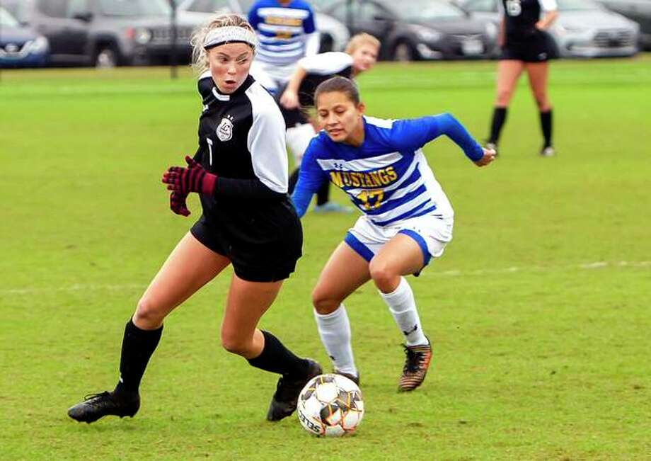 Lewis and Clark's Megan Pierce (5) controls the ball against Monroe's Angie Ponce in Wednesday's pool play game at the NJCAA National women's Soccer Championships in Foley Ala. Monroe won 4-1, ending LCCC's season at 19-1. Photo: Jan Dona | For The Telegraph