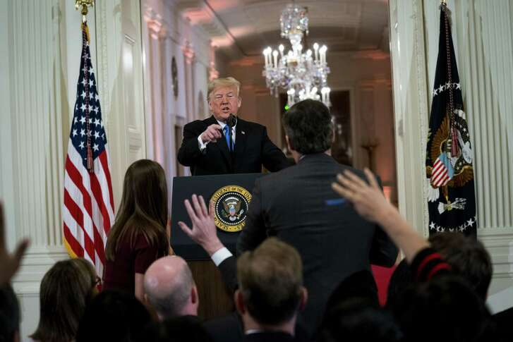 President Donald Trump during a heated exchange with CNN reporter Jim Acosta at a news conference about the results of the midterm elections, at the White House in Washington, Nov. 7, 2018. CNN sued the Trump administration on Nov. 13 in an effort to reinstate the press credentials of Acosta, escalating a dispute that has highlighted the increasingly tense dynamic between Trump and the news media.
