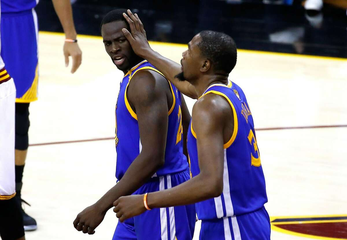 CLEVELAND, OH - JUNE 07: Draymond Green #23 and Kevin Durant #35 of the Golden State Warriors react in the first half against the Cleveland Cavaliers in Game 3 of the 2017 NBA Finals at Quicken Loans Arena on June 7, 2017 in Cleveland, Ohio. NOTE TO USER: User expressly acknowledges and agrees that, by downloading and or using this photograph, User is consenting to the terms and conditions of the Getty Images License Agreement. (Photo by Gregory Shamus/Getty Images)