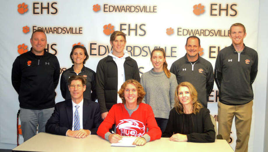 Edwardsville senior Roland Prenzler signed to compete in cross country and track and field at SIUE. In the front row, from left to right, are father Kurt Prenzler, Roland Prenzler and mother Rita Prenzler. In the back row, from left to right, are EHS boys' track and field coach Chad Lakatos, EHS assistant coach Maggie Dust, brother Edward Prenzler, sister Ruth Prenzler, EHS cross country coach George Patrylak and EHS assistant coach Dustin Davis. Photo: Scott Marion/Intelligencer