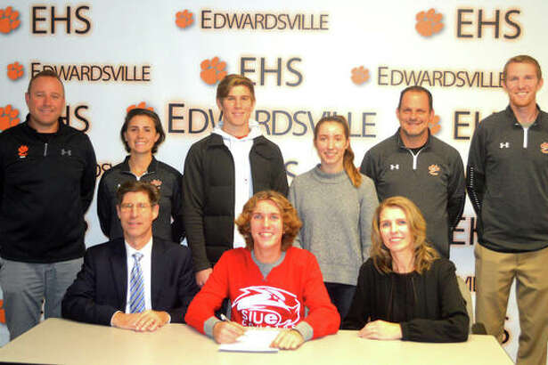 Edwardsville senior Roland Prenzler signed to compete in cross country and track and field at SIUE. In the front row, from left to right, are father Kurt Prenzler, Roland Prenzler and mother Rita Prenzler. In the back row, from left to right, are EHS boys' track and field coach Chad Lakatos, EHS assistant coach Maggie Dust, brother Edward Prenzler, sister Ruth Prenzler, EHS cross country coach George Patrylak and EHS assistant coach Dustin Davis.