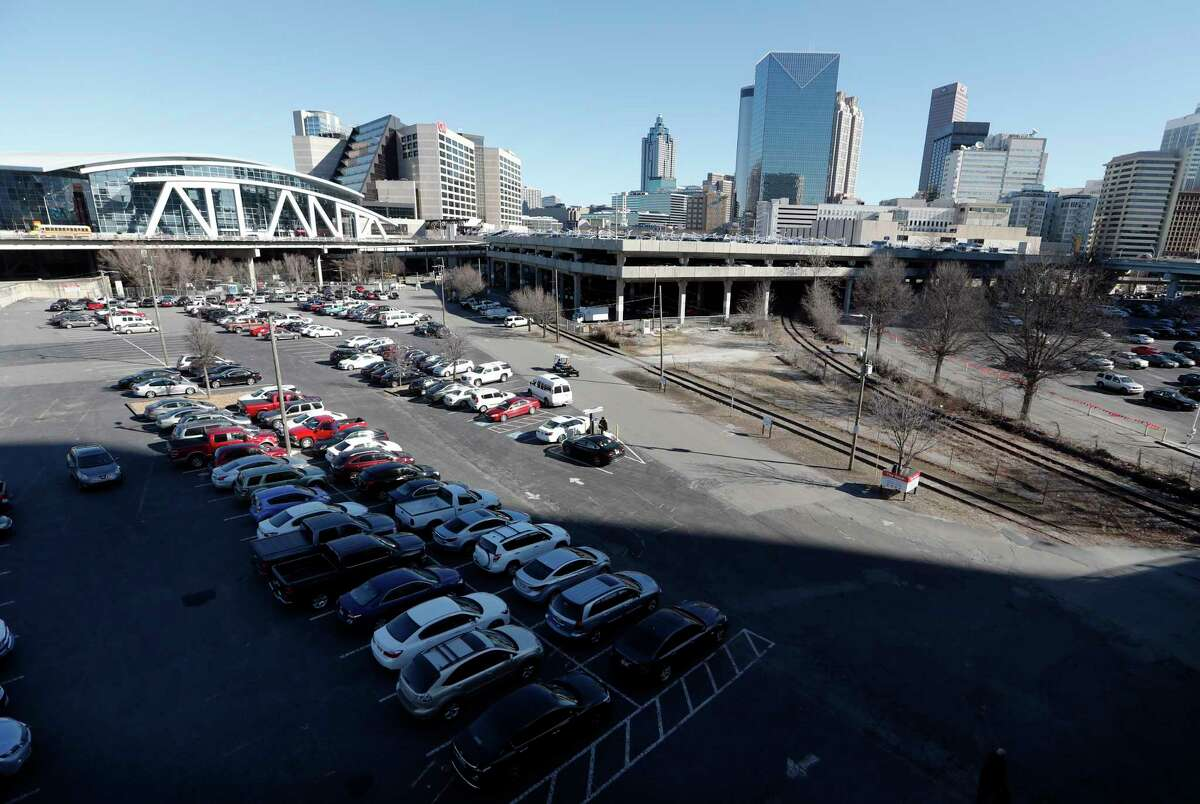 FILE- This Jan. 25, 2018, file photo shows a tract of land known to locals as The Gulch in Atlanta. For more than a year, cities around the country, including Atlanta, waited in suspense over whether they'd be chosen as Amazon's second home. On Tuesday, Nov. 13, Amazon announced that it had picked for its new East Coast headquarters the New York neighborhood of Long Island City, Queens as well as a suburb of Washington, in Arlington, Va.