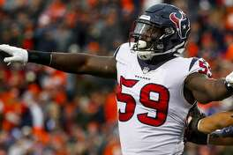 Houston Texans outside linebacker Whitney Mercilus celebrates a tackle against the Denver Broncos during the second half of an NFL football game, Sunday, Nov. 4, 2018, in Denver. (AP Photo/Jack Dempsey)